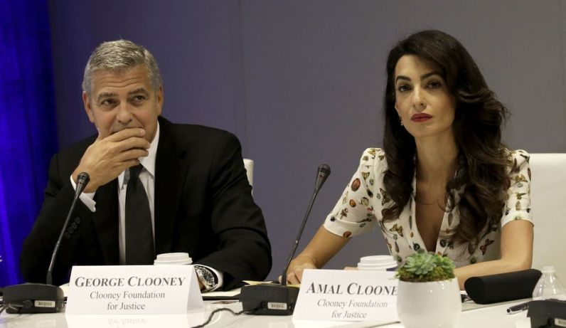 NEW YORK, NY - SEPTEMBER 20: (AFP OUT) Actor George Clooney (L) and wife Amal Clooney attend a Leaders Summit for Refugees during the United Nations 71st session of the General Debate at the United Nations General Assembly on September 20, 2016 in New York, New York. (Photo by Peter Foley - Pool/Getty Images)