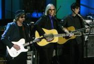 Rock greats Jeff Lynne (L) and Tom Petty play with Dhani Harrison (R), son of ex-Beatle George Harrison, at the 19th Annual Rock and Roll Hall of Fame Induction Ceremony in New York on March 15, 2004. REUTERS/Jeff Christensen