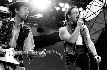The Edge and Bono of U2 perform on stage on The Joshua Tree Tour at Feyenoord Stadion, De Kuip, Rotterdam ,Netherlands, 10th July 1987. The Edge is playing a Gibson Explorer guitar. (Photo by Rob Verhorst/Redferns)