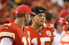 KANSAS CITY, MO - AUGUST 11: Kansas City Chiefs quarterback Alex Smith (11) reviews plays on a table with Patrick Mahomes (15) in the fourth quarter of an NFL week 1 preseason game between the San Francisco 49ers and the Kansas City Chiefs on August 11th, 2017 at Arrowhead Stadium in Kansas City, MO. The 49ers won 27-17. (Photo by Scott Winters/Icon Sportswire via Getty Images)